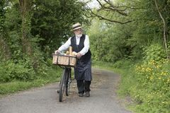 1940 delivery man on a country road. In a rural setting royalty free stock photography
