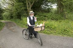 1940 delivery man on a country road. In a rural setting stock images