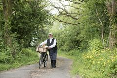 1940 delivery man on a country road. Rural setting royalty free stock photo