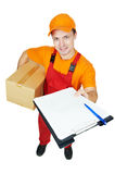 Delivery man courier with parcel cardboard box royalty free stock photography