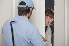Delivery man with crowbar Royalty Free Stock Photo