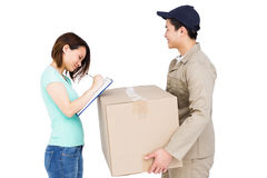 Delivery man with customer Royalty Free Stock Photography