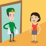 Delivery man delivering groceries to customer. Stock Image