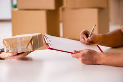 The delivery man delivering parcel box Stock Images