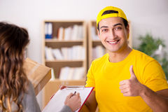 The delivery man delivering parcel box Stock Photos