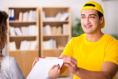 The delivery man delivering parcel box Stock Photography
