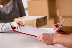 The delivery man delivering parcel box Stock Image