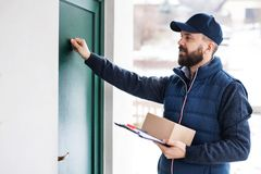 Delivery man delivering parcel box to recipient. Stock Photography