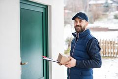 Delivery man delivering parcel box to recipient. royalty free stock photo