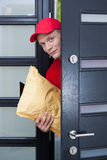 Delivery man at the doorstep Stock Images