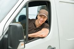 Delivery Man Driving Van Stock Photography