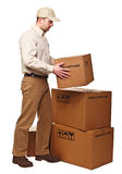Delivery man on duty Stock Images