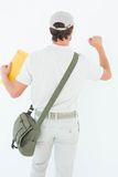 Delivery man with envelop knocking on white background Royalty Free Stock Images