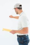 Delivery man with envelop knocking on white background Royalty Free Stock Image