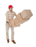 Delivery man with falling stack of boxes. Isolated on white Royalty Free Stock Photos