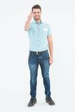 Delivery man gesturing thumbs up. Full length portrait of handsome young delivery man gesturing thumbs up on white background Royalty Free Stock Image