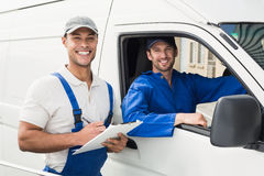 Delivery man getting signature from customer Royalty Free Stock Photography