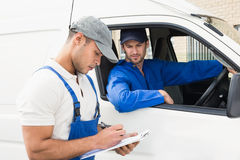 Delivery man getting signature from customer Stock Photos