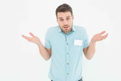 Delivery man giving I dont know gesture. Portrait of confised delivery man giving I dont know gesture on white background Royalty Free Stock Photo