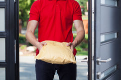 Delivery man giving a package Stock Photo