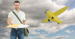 Delivery man giving parcel with airplane in background Royalty Free Stock Photos
