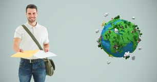 Delivery man giving parcel by low poly earth Stock Photo