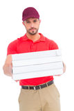 Delivery man giving pizza boxes Stock Photos