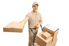 Delivery man with a hand truck loaded with boxes giving a packag. E isolated on white background Stock Photography