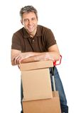 Delivery man with hand truck and stack of boxes. Isolated on white Stock Photos