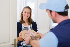 Delivery man handing over a parcel to customer Royalty Free Stock Image