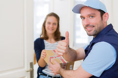 Delivery man handing over a parcel to customer Stock Photography
