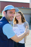 Delivery man handing over a registered letter Royalty Free Stock Photo