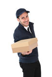 Delivery man handing package Royalty Free Stock Image