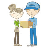 Delivery man handing a package to woman Stock Photo