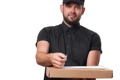 Delivery man handing parcel box to recipient stock photo