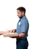 Delivery man handing parcel box to recipient - courier service concept Royalty Free Stock Photos