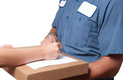Delivery man handing parcel box to recipient - courier service concept Royalty Free Stock Images