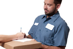 Delivery man handing parcel box to recipient - courier service concept Royalty Free Stock Image