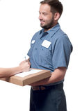 Delivery man handing parcel box to recipient - courier service concept Stock Photography