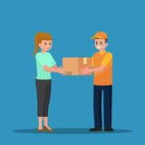 Delivery man handing a parcel to woman customer. Stock Photos