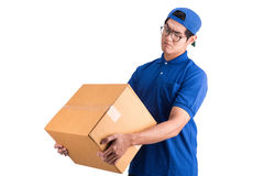 Delivery man having doubts in product box. Stock Photo