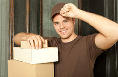 Delivery man with his cap Stock Images