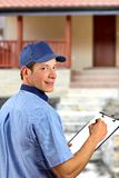 Delivery man with his schedule Stock Photo