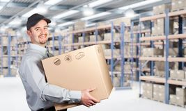 Man with boxe. Delivery man hold box in warehouse stock photos