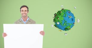 Delivery man holding blank billboard by low poly earth Royalty Free Stock Images