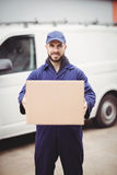 Delivery man holding box Royalty Free Stock Image