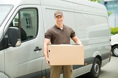 Delivery Man Holding Box Stock Image