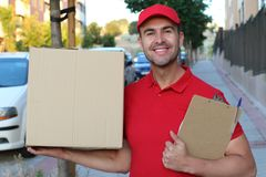 Delivery man holding a box outdoors royalty free stock photos
