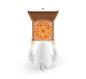 Delivery man holding box with tasty pizza hand top view Stock Images