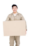 Delivery man holding cardboard box Stock Image